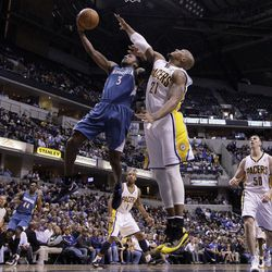 Indiana Pacers forward David West, right, defends Minnesota Timberwolves guard Malcolm Lee as he shoots during the first half of an NBA basketball game in Indianapolis, Monday, April 16, 2012.