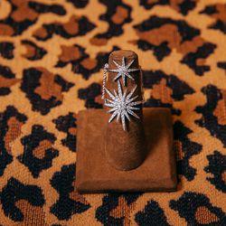 <b>Djula</b> white gold and diamond double star burst ring, $5,095.