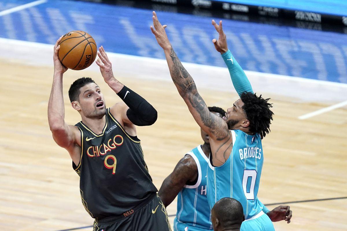 The Bulls' Nikola Vucevic shoots over the  Hornets' Miles Bridges during the first half Thursday night.