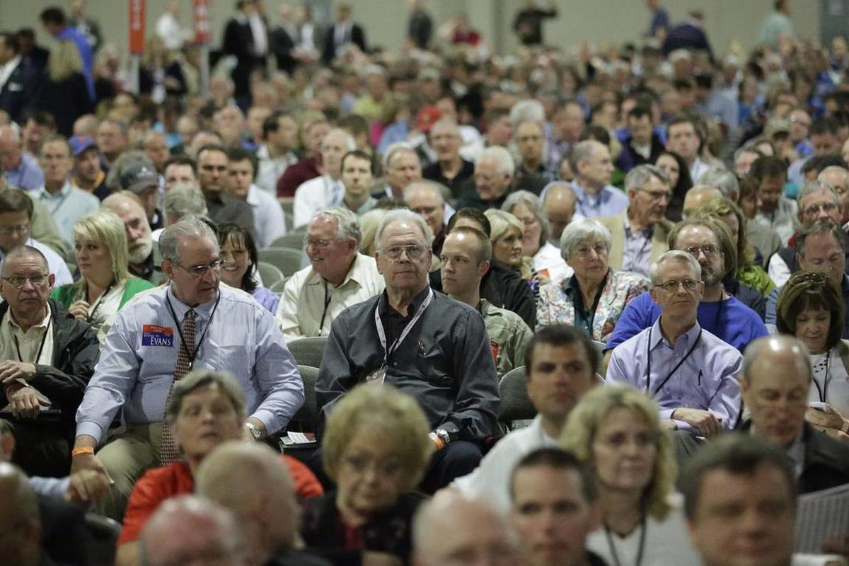 This May 18, 2013, file photo, shows people looking on during the Utah Republican Party's annual organizing convention, in Sandy, Utah. Utah Republicans pushing for reforms in their state caucus and convention system say they're moving forward with a plan