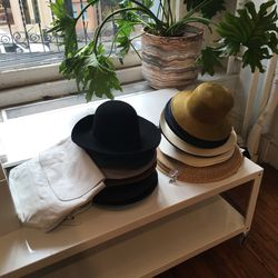 Clyde hats (starting at $88) and backpack