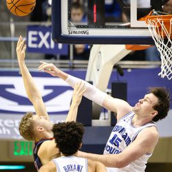Brigham Young Cougars forward Payton Dastrup (15) swats St. Mary's Gaels center Jock Landale (34) shot in the first half as the BYU Cougars take on the Saint Mary's Gaels in the Marriott Center in Provo on Saturday, Dec. 30, 2017.