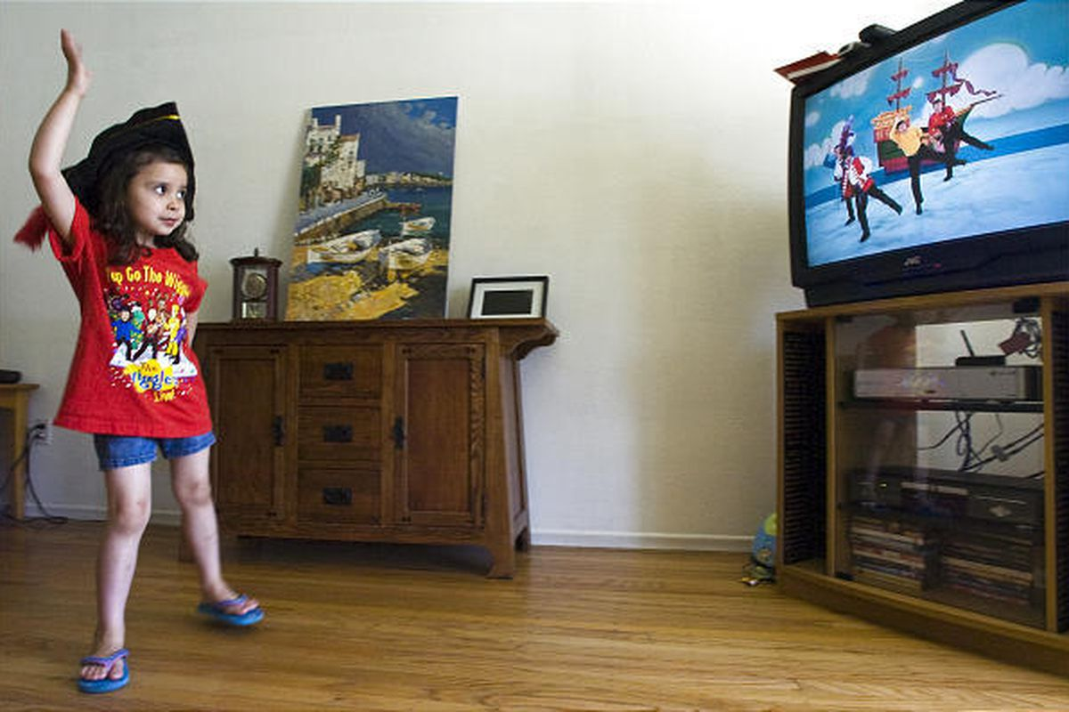 """Vanessa Mendoza, 4, dances to the """"Wiggles,"""" at her home. Mendoza and her younger sister love the Wiggles and have been to concerts in the past."""