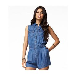 """The versatility of chambray has made it a staple in our closets, and we especially love it in this playful incarnation. You could wear this romper about a million ways, but for some summer fun try going a little """"country"""" with a side braid and boots, or k"""