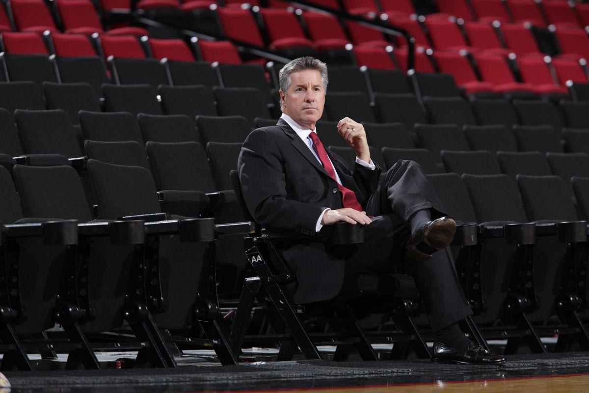 Neil Olshey sitting