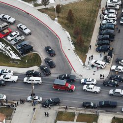Police respond to Pleasant Grove High School, which was placed on lockdown on Thursday, Dec. 3, 2015, in Pleasant Grove. A report of a man with a gun in the building turned out to be false.