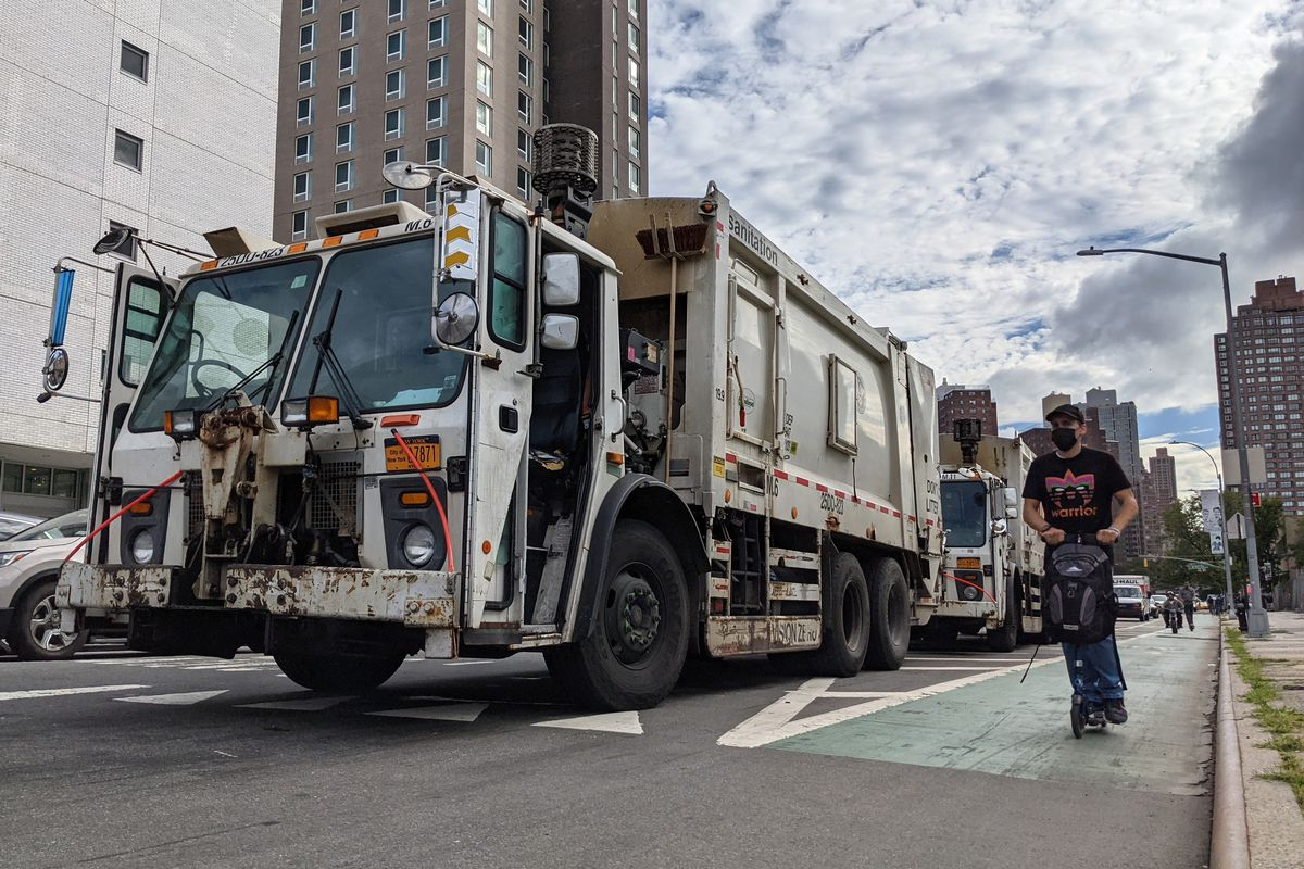 The Department of Sanitation parks trucks outside its garage on East 99th Street and First Avenue, Sept. 23. 2021.