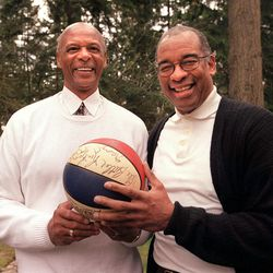 Zelmo Beaty and Willey Wise, former Utah Stars basketball standouts hold an old ABA basketball that was signed by the team.