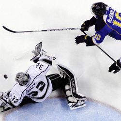 Los Angeles Kings goalie Jonathan Quick (32) deflects a shot as St. Louis Blues' Andy McDonald gives chase during the second period of Game 1 in a second-round NHL Stanley Cup hockey playoff series, Saturday, April 28, 2012, in St. Louis.