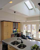 <p>The new kitchen scores on three important points: increased natural light, ample room for an informal meal and a convenient link to the backyard.</p>