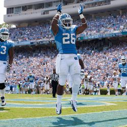 North Carolina's Giovani Bernard (26) celebrates after scoring a touchdown against Elon in the first quarter of an NCAA college football game, Saturday Sept. 1, 2012, at Kenan Stadium in Chapel Hill, N.C.