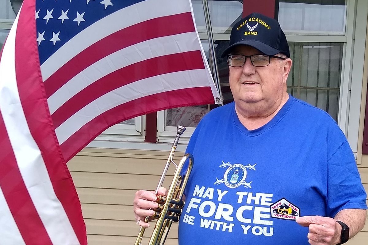 """Douglas Lindt, of Elk Grove Village, participated in Taps Across America for the second year and is holding a patch that reads """"Taps for Veterans."""""""