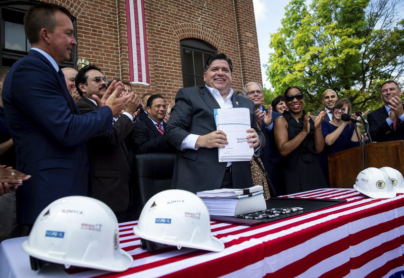 Gov. J.B. Pritzker signs a massive expansion of gambling in Illinois and a $45 billion construction and infrastructure plan