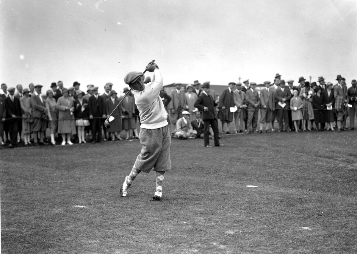 American champion golfer Bobby Jones (1902 - 1971) driving off at St Andrews where he won the British Open Golf Championship with a record score of 285.