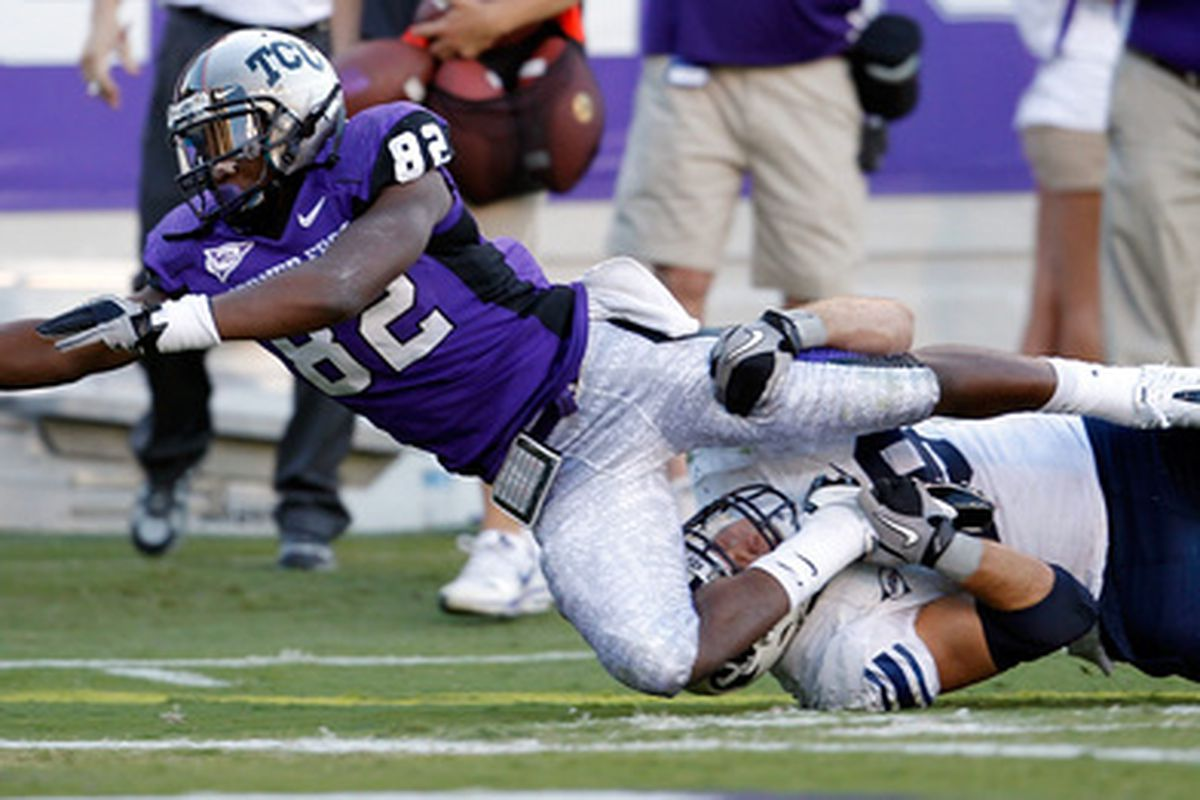 TCU Boyce often performs pilates during football games. Sign of a lack of focus or versatility? Only true draftniks shall be able to decipher such a living Rubik's cube. (Photo by Tom Pennington/Getty Images)