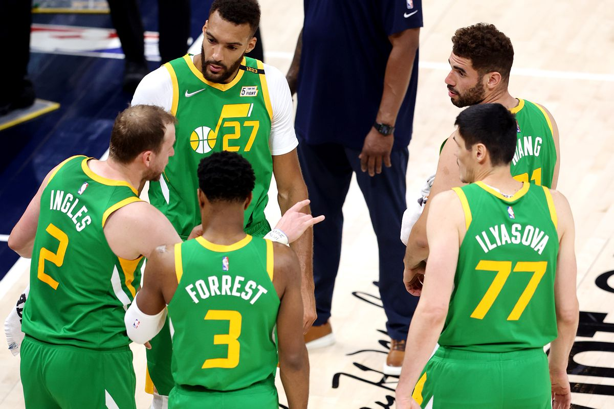 Jazz players talk during a foul review as the Jazz and Nuggets play at Vivint Arena in Salt Lake City on May 7.