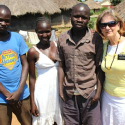 Opedmoth Cosmas, third from left, stands with his brother Reagan Owekonga, left, his sister-in-law Alanyo Joyce, and Sister RaNae Taylor, right, in Gulu, Uganda. Sister Taylor and her husband, Elder Bernell Taylor, of Mapleton, are serving a mission in Uganda where they met Cosmas, a 23-year-old man who lost both of his hands in a machinery accident. The Taylors' neighbors in Mapleton are trying to raise nearly $30,000 to bring Cosmas to Utah to be fitted for prosthetic hands.