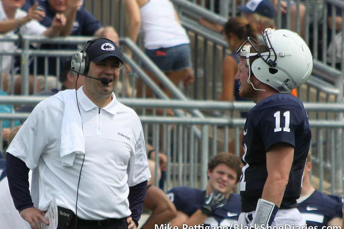 """Sept. 1, 2012; Bill O'Brien talks with Matt McGloin between plays. Penn State fell to the Ohio Bobcats, 24-14. (<a href=""""http://www.flickr.com/photos/mikepettigano/7928538500/in/set-72157631399895340/"""" target=""""new"""">Photo by Mike Pettigano</a>)"""
