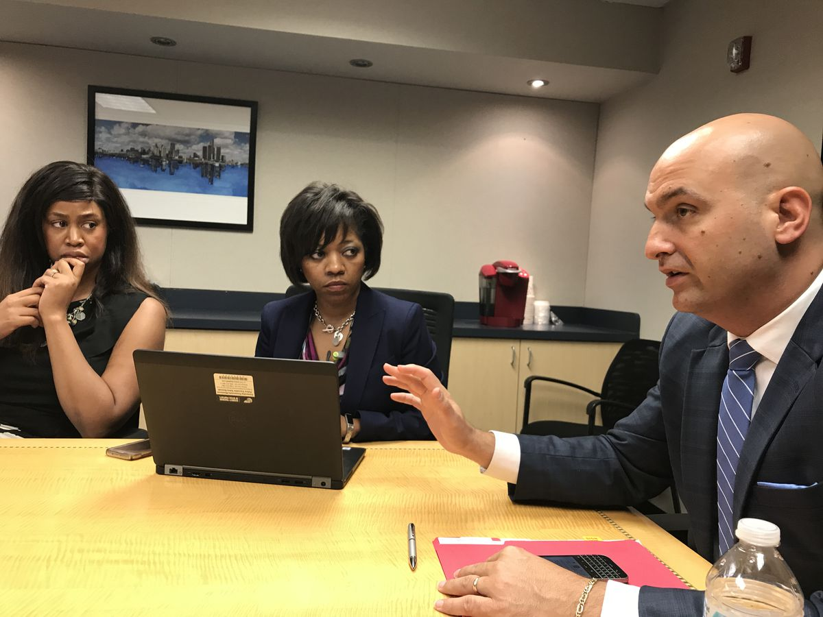Superintendent Nikolai Vitti speaks during a meeting in a large conference room.