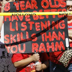 """A young boy holds up a sign critical of Chicago mayor Rahm Emanuel during a rally of striking Chicago school teachers Saturday, Sept. 15, 2012, in Chicago. Union president Karen Lewis reminded the crowd that although there is a """"framework"""" for an end to their strike, they still are on strike."""