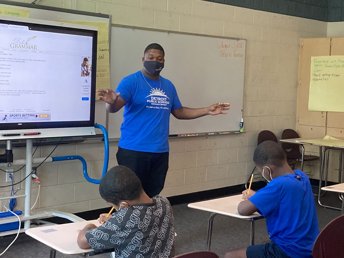 A man teaches a group of students in a summer school class in the Detroit school district.