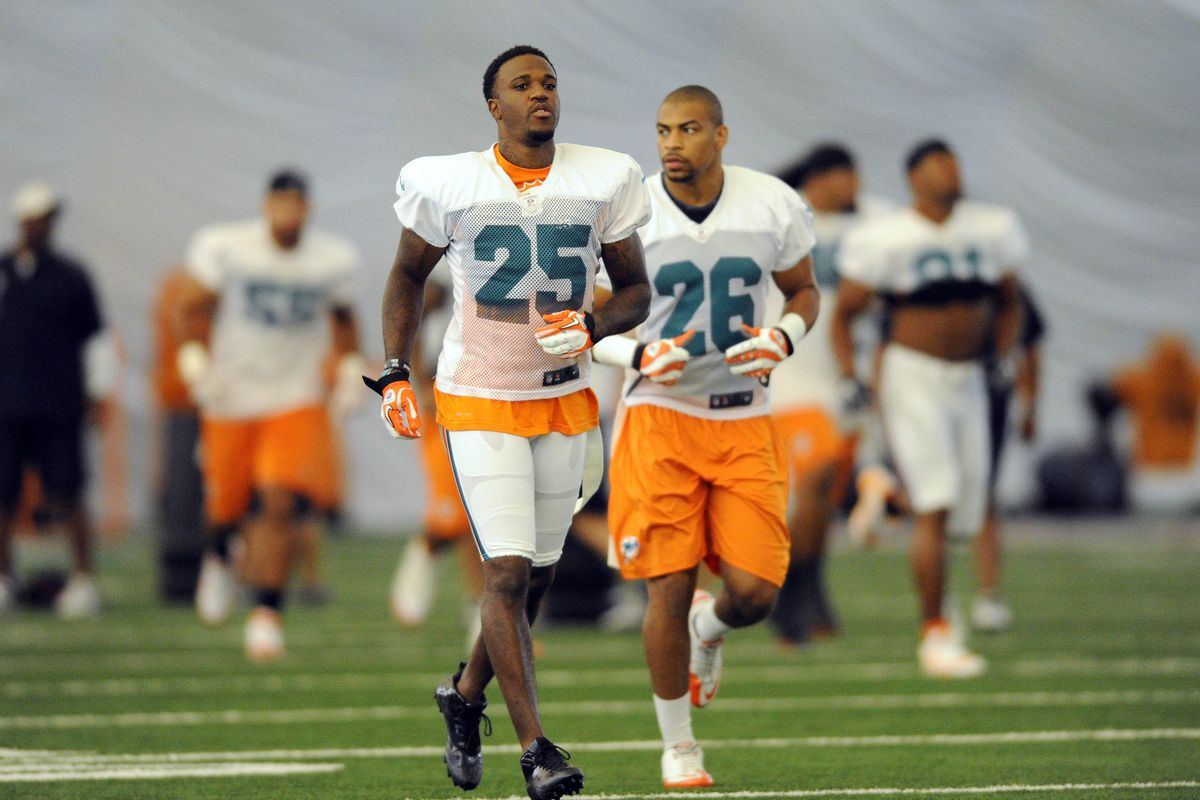 July 28 2012; Davie, FL, USA; Miami Dolphins defensive back Jonathan Wade (left) and defensive back Tyrell Johnson (right) both run during practice drills at the Dolphins training facility. Mandatory Credit: Steve Mitchell-US PRESSWIRE