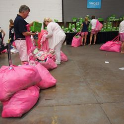 Many people resorted to dragging their heavy, overstuffed pink bags behind them on the ground.