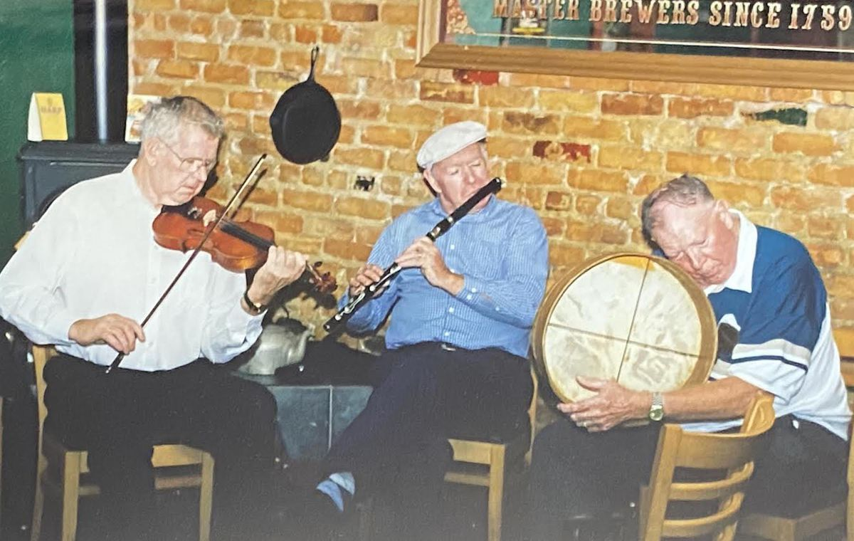 Malachy Towey (right, on bodhran) and flautist friend Kevin Henry and fiddler Frank Burke.