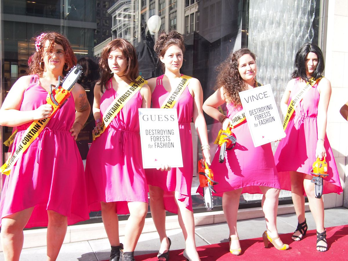 Women in pink dresses protesting again companies that use rainforest-derived rayon