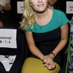 FILE - In this Sept. 8, 2011 file photo, actress Elisha Cuthbert attends the BCBG Max Azria Spring 2012 fashion show during Mercedes-Benz Fashion Week in New York. Most of us can pair one bold color with another _ it just takes a little confidence. But colorblocking, with contrasting chunks of color, it's more of an art, and it's one to be mastered this spring season.