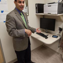 ADVANCE FOR WEEKEND EDITIONS SEPT. 29-30 - In this Sept. 20, 2012 photo, Dr. Rami Boutros explains the on stage off stage concept being implemented at the new University of Iowa Hospitals Iowa River Landing clinics in Coralville, Iowa.