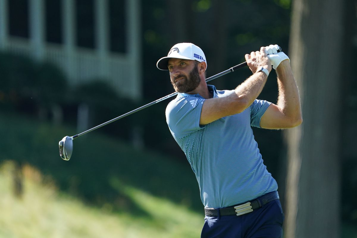 Dustin Johnson tees off on the 18th during the second round of the Travelers Championship golf tournament at TPC River Highlands.