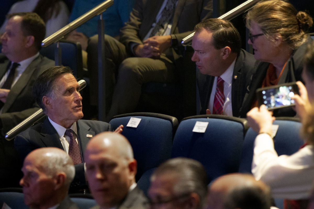 """Sens. Mitt Romney, left, and Mike Lee speak before """"Integrity and Trust: Lessons from Watergate and Today"""" at the Newseum in Washington, D.C., on Monday, Jan. 14, 2019."""