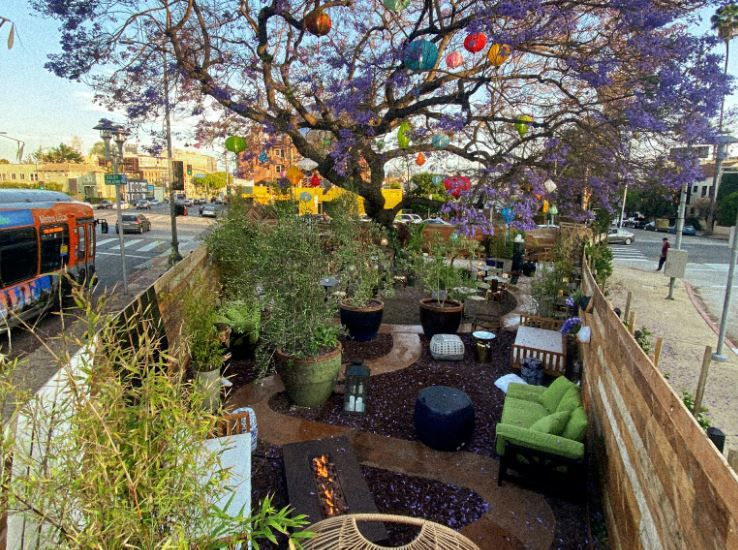 Outdoor park dining room at Mokuzai in Hollywood.