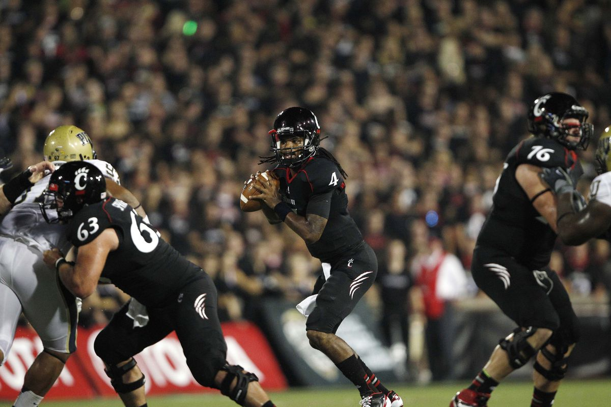Sep 6, 2012; Cincinnati, OH, USA; Cincinnati Bearcats quarterback Munchie Legaux (4) drops back to pass during the first half against the Pittsburgh Panthers at Nippert Stadium. Mandatory Credit: Frank Victores-US PRESSWIRE