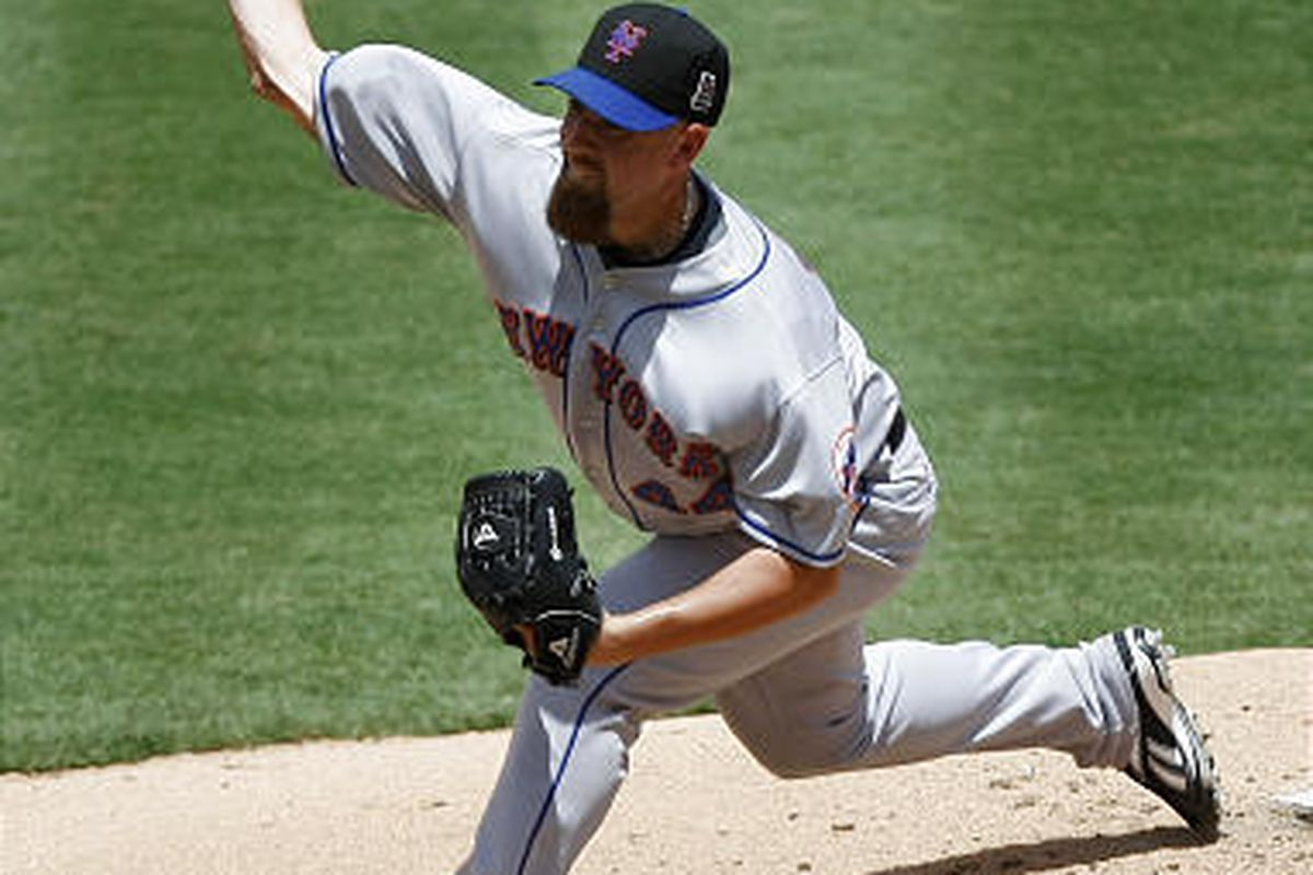 Tim Redding pitches against the Florida Marlins as the Mets matched a season-high 17 hits.