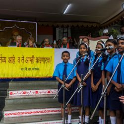 Elder D. Todd Christofferson, a member of the Quorum of Twelve Apostles for The Church of Jesus Christ of Latter-day Saints, and other dignitaries listen to a song performance by students during the 71st Independence Day celebrations at the MIT World Peace University in Pune, Maharashtra, India, on August 15, 2017.