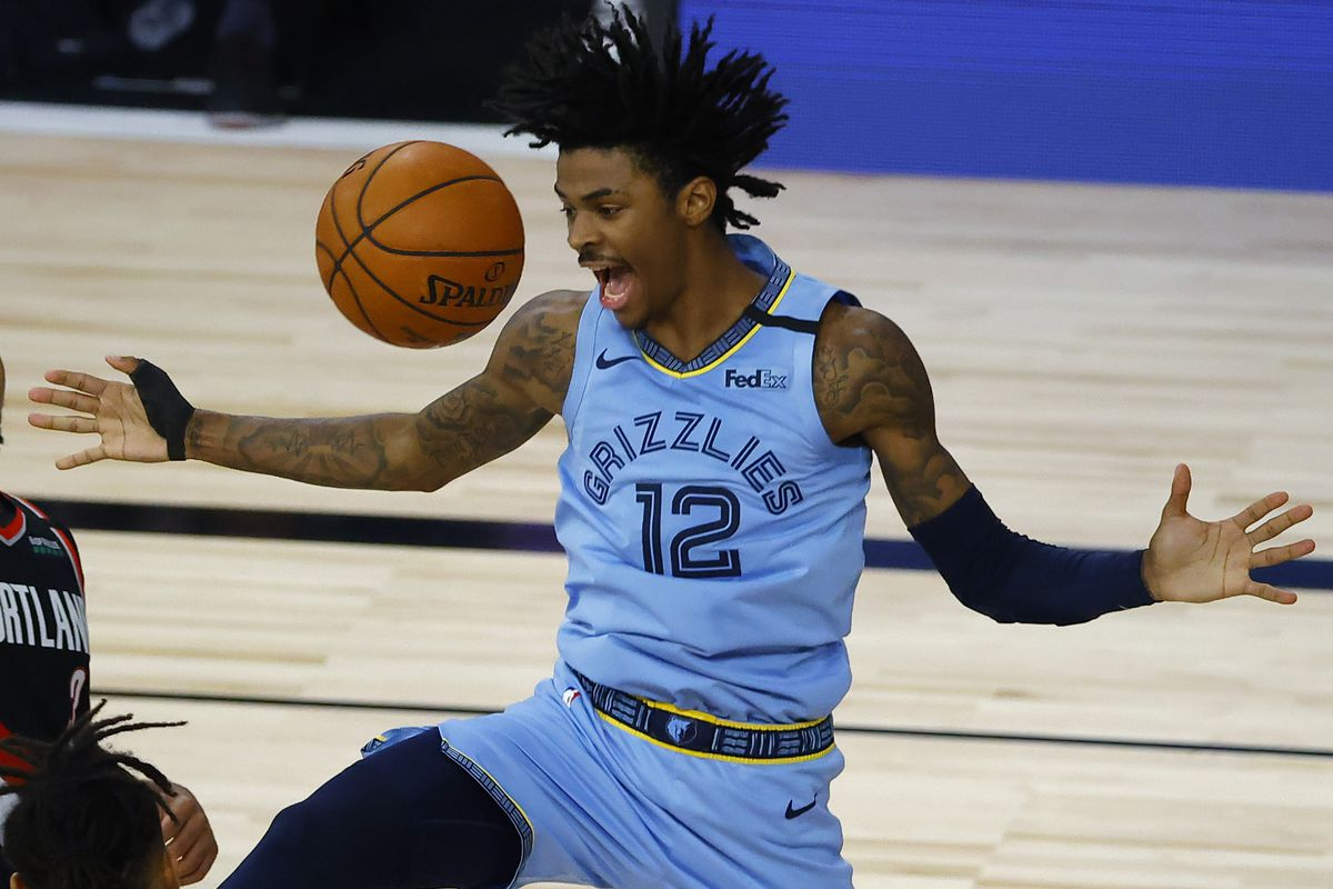 Ja Morant of the Memphis Grizzlies reacts after a dunk against the Portland Trail Blazers during the fourth quarter in the Western Conference play-in game one at The Field House at ESPN Wide World Of Sports Complex on August 15, 2020 in Lake Buena Vista, Florida.
