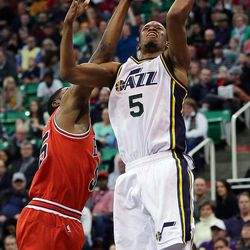 Utah Jazz guard Rodney Hood (5) is defended by Chicago Bulls guard E'Twaun Moore (55) during NBA basketball in Salt Lake City, Monday, Feb. 1, 2016.