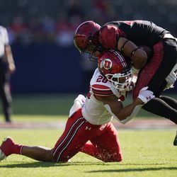 Utah safety Brandon McKinney (28) tackles San Diego State wide receiver Jesse Matthews (45) during the first half of an NCAA college football game Saturday, Sept. 18, 2021, in Carson, Calif.