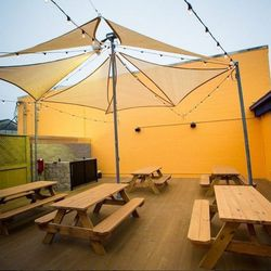 """7.) <a href=""""http://nola.eater.com/tags/mopho"""">Mopho's</a> deck, where on the weekends chef Michael Gulotta is known to roast pigs for his Super Swine Saturday. The restaurant has also been doing live music on the weekends."""