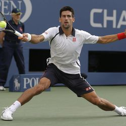 Serbia's Novak Djokovic returns a shot to Spain's David Ferrer during a semifinal match at the 2012 US Open tennis tournament,  Saturday, Sept. 8, 2012, in New York. The U.S. Open will finish on a Monday for the fifth consecutive year. With a potentially dangerous storm expected Saturday night in Flushing Meadows, the tournament suspended play for the day while David Ferrer was leading Novak Djokovic 5-2 in the first set of their semifinal.