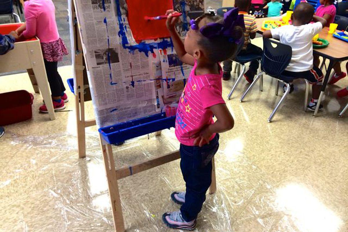 A preschooler at IPS School 102 paints a picture.