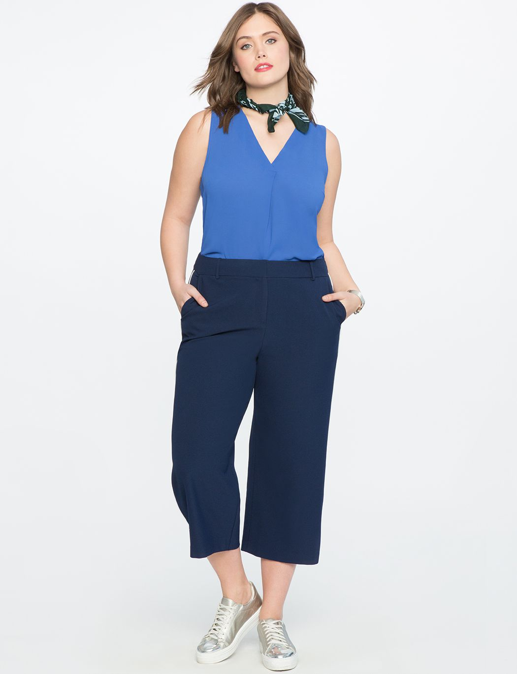 A model in blue culottes and a blue tank