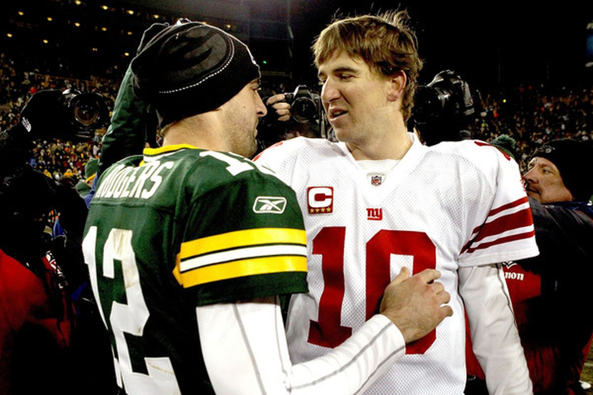 GREEN BAY WI - DECEMBER 26:  Aaron Rodgers #12 of the Green Bay Packers is congratulated by Eli Manning #10 of the New York Giants after their game at Lambeau Field on December 26 2010 in Green Bay Wisconsin.  (Photo by Matthew Stockman/Getty Images)