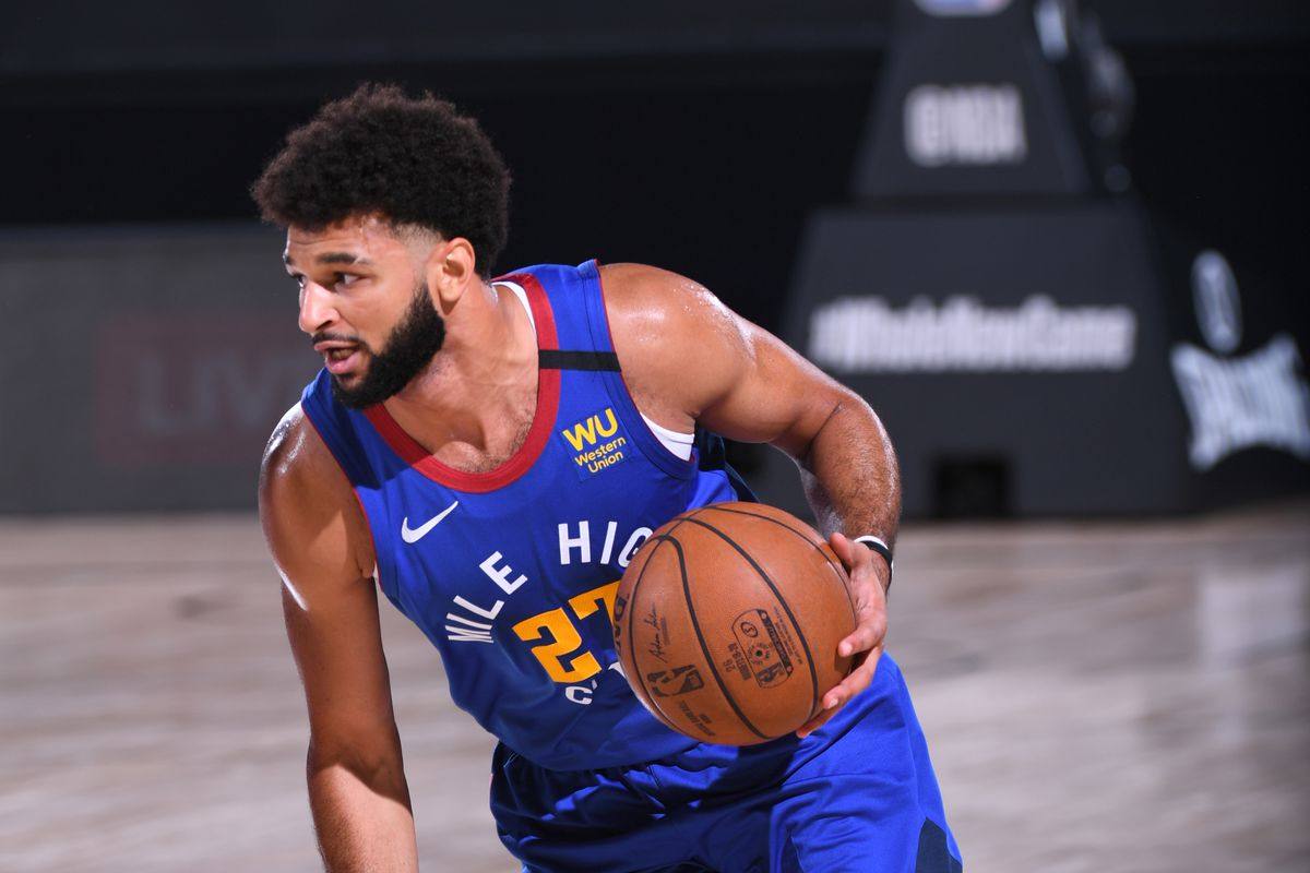 Jamal Murray of the Denver Nuggets handles the ball against the LA Clippers on August 12, 2020 at the AdventHealth Arena at in Orlando, Florida.