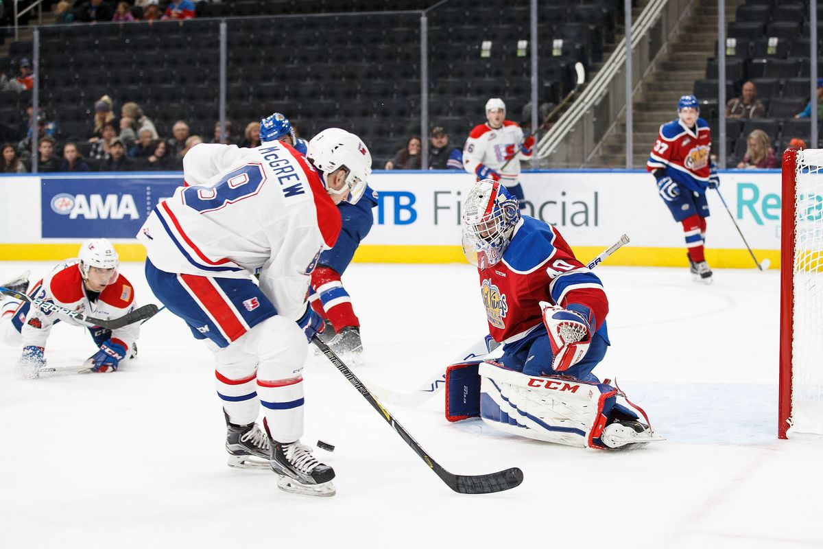 EDMONTON, AB - OCTOBER 22: Goaltender Travis Child #40 of the Edmonton Oil Kings makes a save against Jake McGrew #8 of the Spokane Chiefs at Rogers Place on October 22, 2017 in Edmonton, Canada.