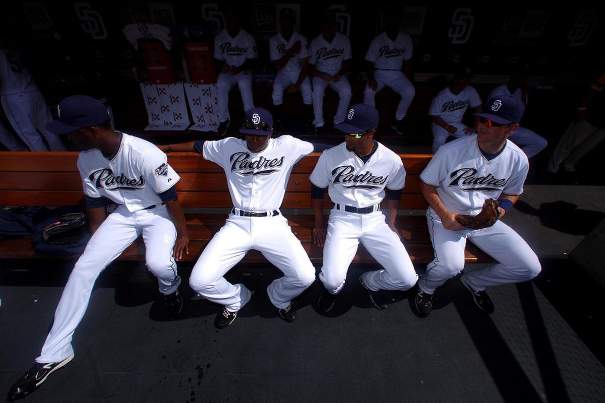 SAN DIEGO, CA - APRIL 5:  Members of the San Diego Padres sit in the dugout before the start of their team's MLB Game against the San Francisco Giants at Petco Park on April 5, 2011 in San Diego, California. (Photo by Donald Miralle/Getty Images)