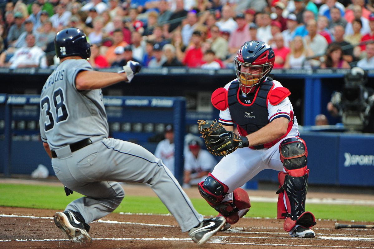 ATLANTA, GA - AUGUST 16: Jason Marquis #38 of the San Diego Padres is tagged out a home by Brian McCann #16 of the Atlanta Braves at Turner Field on August 16, 2012 in Atlanta, Georgia. (Photo by Scott Cunningham/Getty Images)