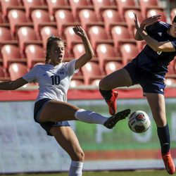 Bonneville's Courtnie Porter (10) kicks the ball past Skyline's Rozlin Gomez (30) during the second half of the 5A girls state championship at Rio Tinto Stadium in Sandy on Friday, Oct. 25, 2019. Skyline defeated Bonneville in overtime 2-1 to take home the state title.